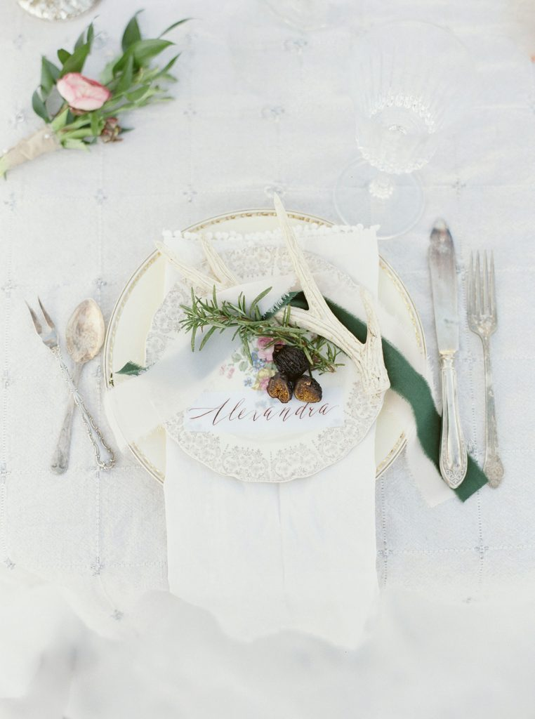 winter wedding table setting with fig & antler and sweeping calligraphy place card